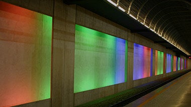 Colourful red, green and blue screen projections on wall